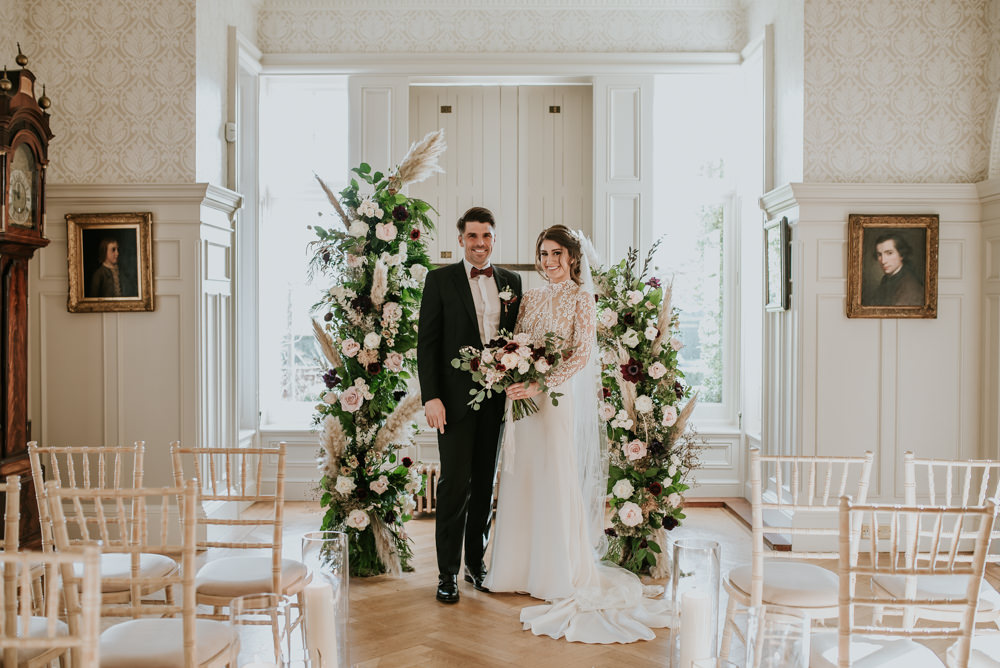 Chippenham Park Wedding Daniel Ackerley Photography Pillar Candles Aisle Decor Ceremony Flower Arch Instalation Backdrop