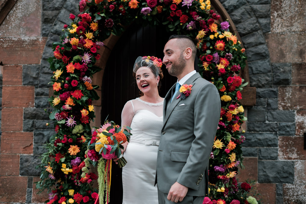 Glenarm Castle Wedding Jonathan Ryder Photography Flower Arch Church Ceremony Colourful