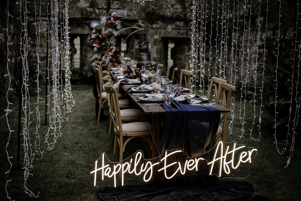 Fairy Light Tunnel Table Tablescape Decor Candles Runner Navy Neon Sign Midsummer Night's Dream Wedding Ideas Dani Louise Photography