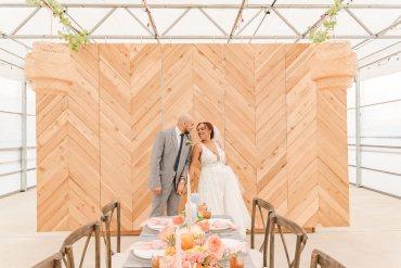 Citrus Wedding Ideas Pearls & Pines Photography Greenhouse Reception Venue Chevron Wooden Wall Backdrop