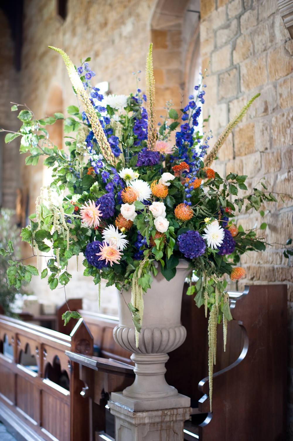 Flower Arrangement Church Blue Orange Floral Wedding Rachael Connerton Photography