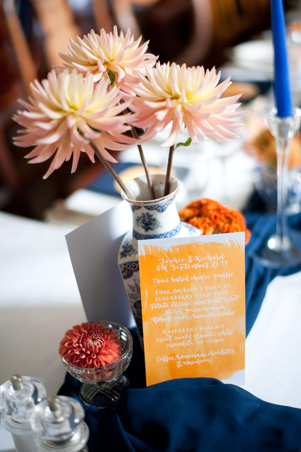 Coral Orange Dahlias Centrepiece Flowers Table Candles Blue Cloth Table Name Floral Wedding Rachael Connerton Photography