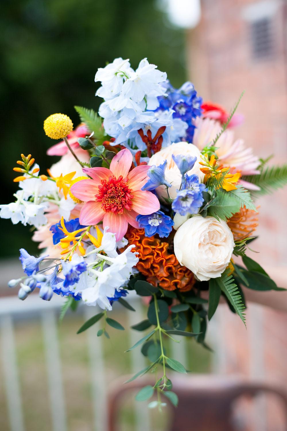Bouquet Flowers Bride Bridal Colourful Ribbon Orange Blue Delphinium Rose Bridesmaid Floral Wedding Rachael Connerton Photography