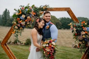 Orange Blue Wedding Steph Kiely Photography Hexagon Flower Arch Backdrop