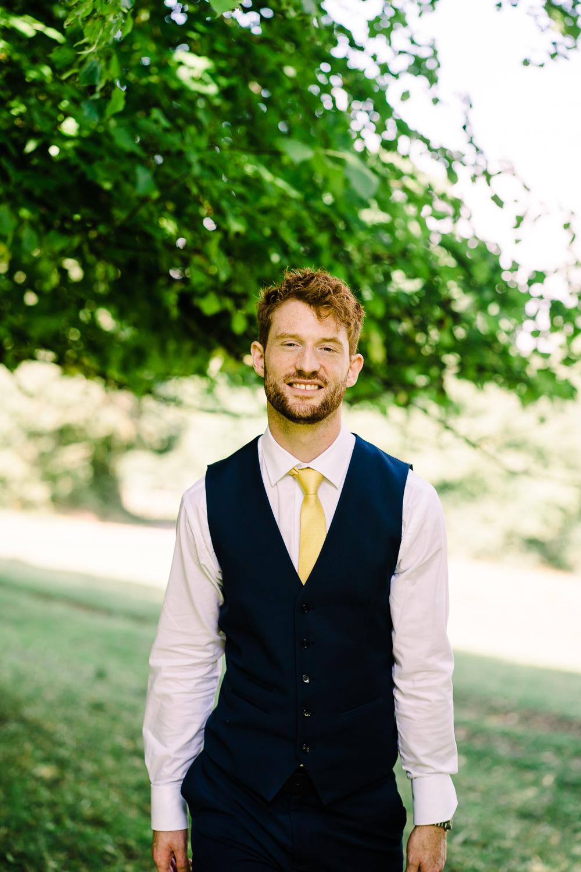 Groom Suit Navy Waistcoat Yellow Tie Garden Wedding Reception Jade Touron Photography