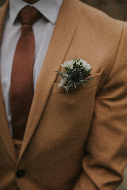 TGroom Suit Tan Camel Tie Buttonhole Flowers Pocket hirlestane Castle Wedding Bernadeta Kupiec Photography