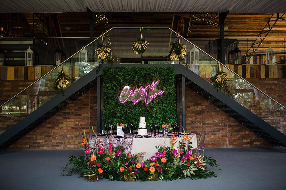 Tablescape Table Decor Pink Orange Tropical Flowers Palm Flower Wall Jungle Wedding Ideas Terri Pashley Photography