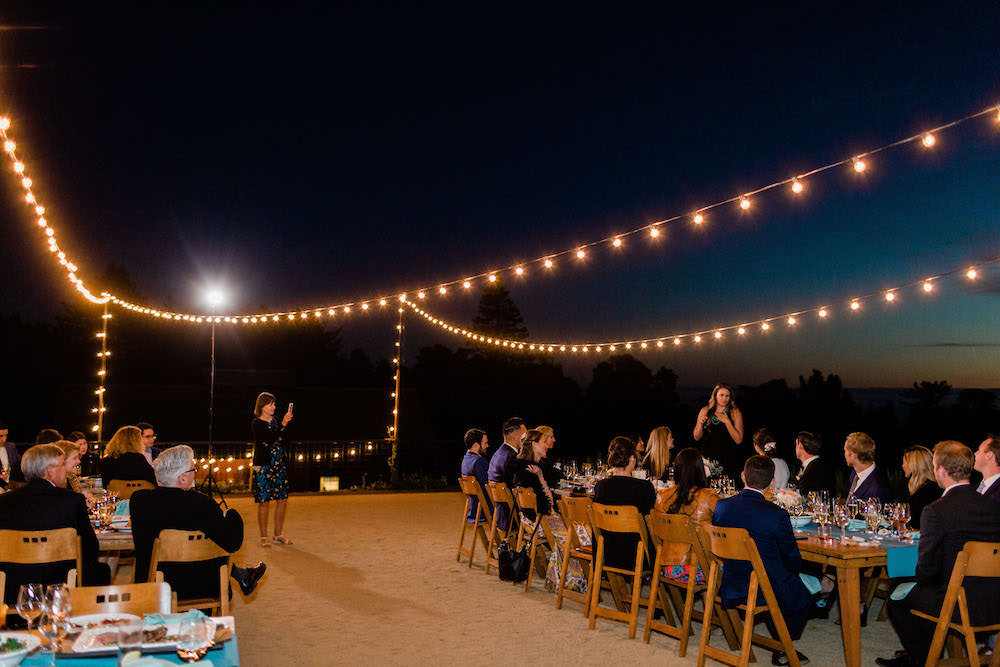Outdoor Reception Long Wooden Tables Festoon Lights Pacific Coast Wedding Mallory Miya Photography