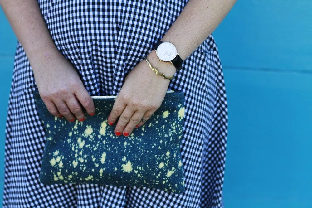 Claire V denim clutch and Daniel Wellington Watch