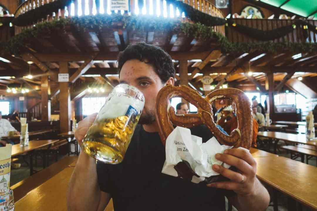 Oktoberfest Munich augustiner man holding pretzel