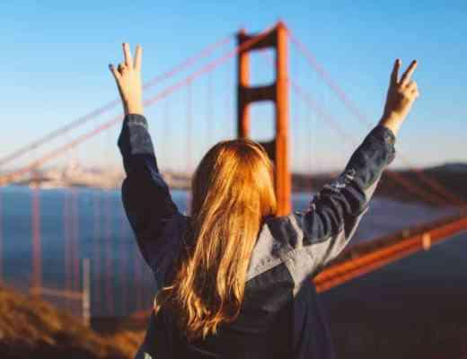 woman peace sign Golden Gate Bridge San Francisco