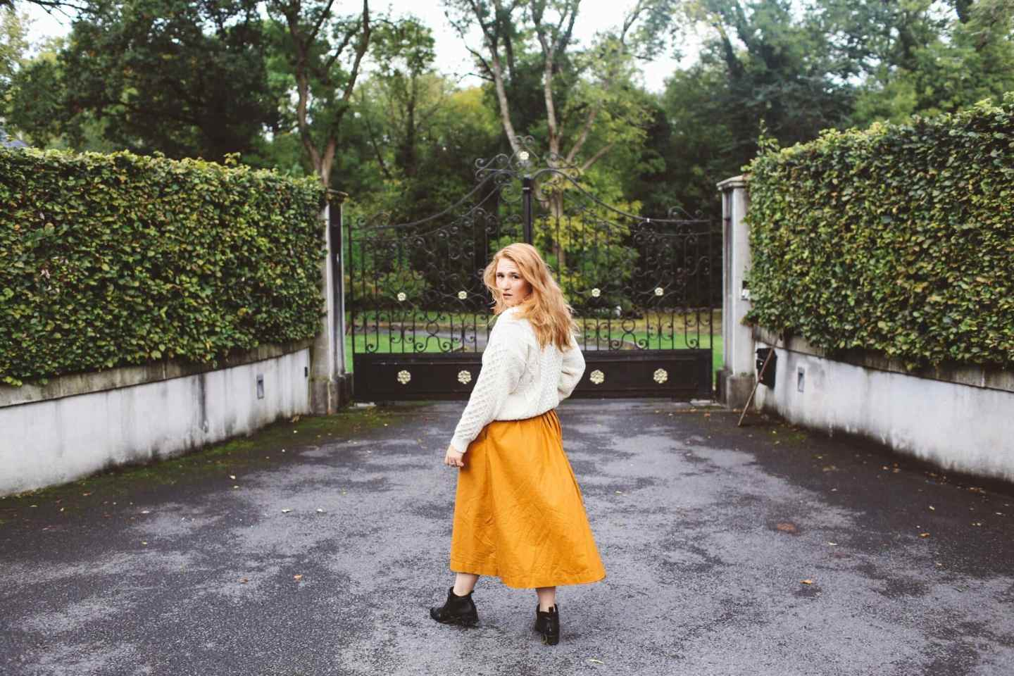 woman white sweater orange midi skirt ireland