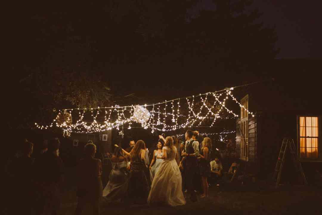 wedding dance floor string lights woods outdoor