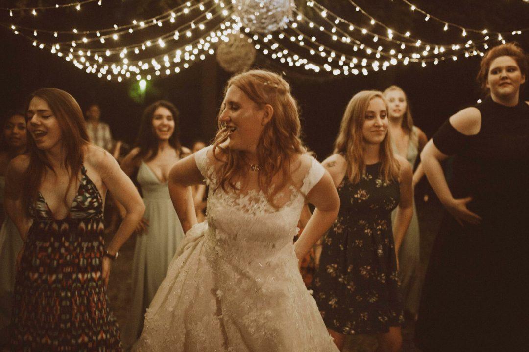 bride dancing wedding string lights