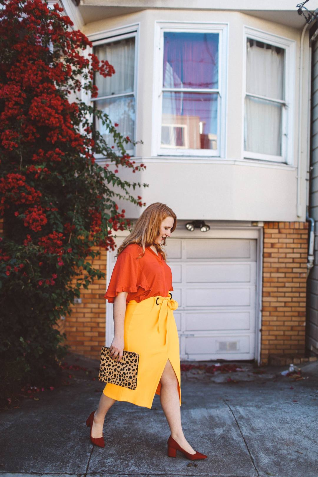 yellow wrap skirt red blouse leopard purse
