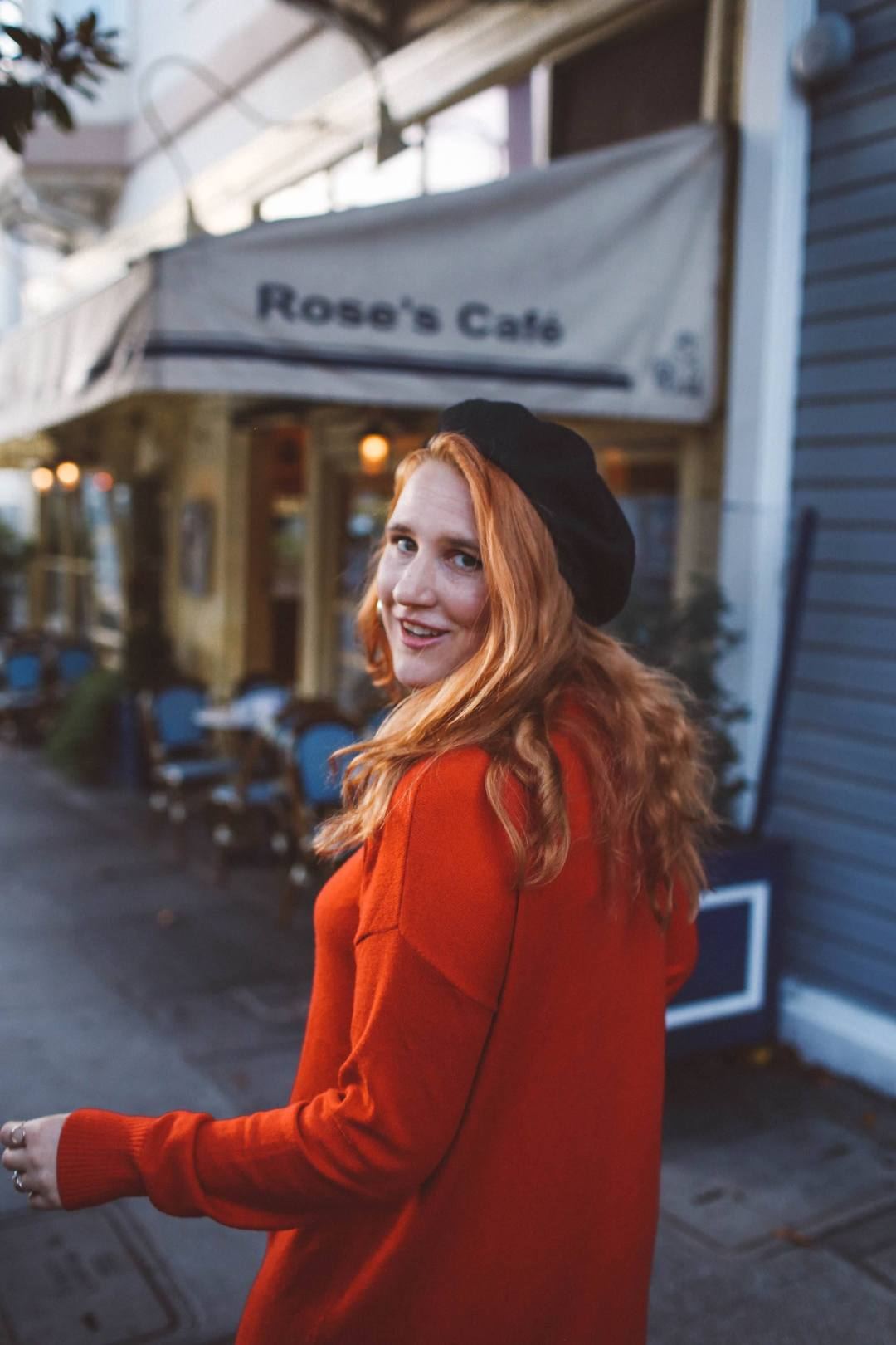 red sweater dress beret rose's cafe san francisco