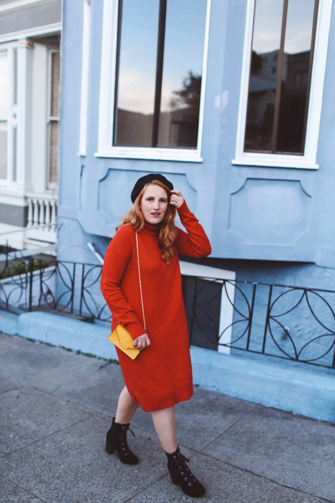 red sweater dress beret yellow purse combat boots