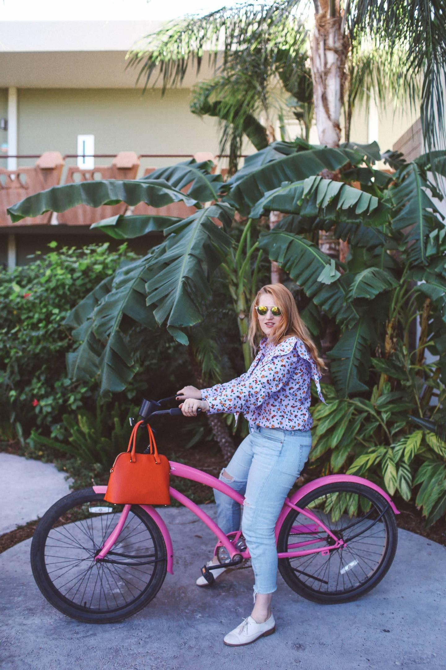 purple ruffle top pink bike palm trees