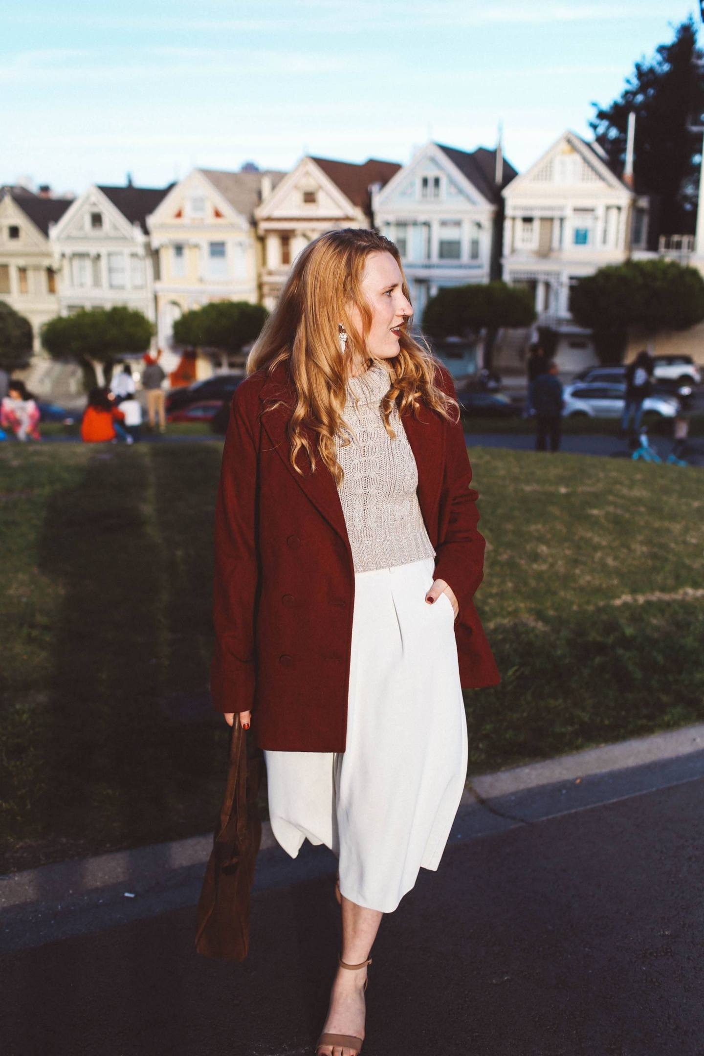 red coat white pants painted ladies