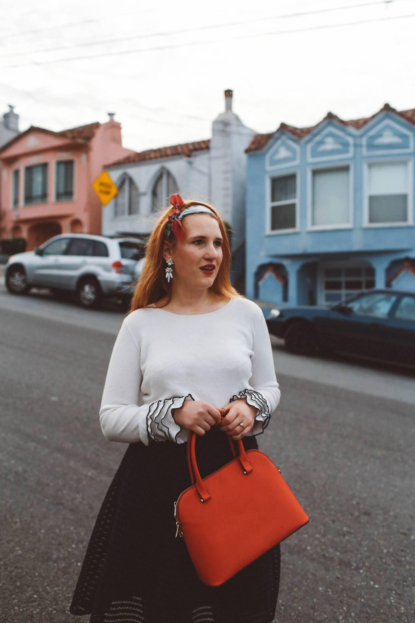 head scarf red purse black skirt ruffle sweater