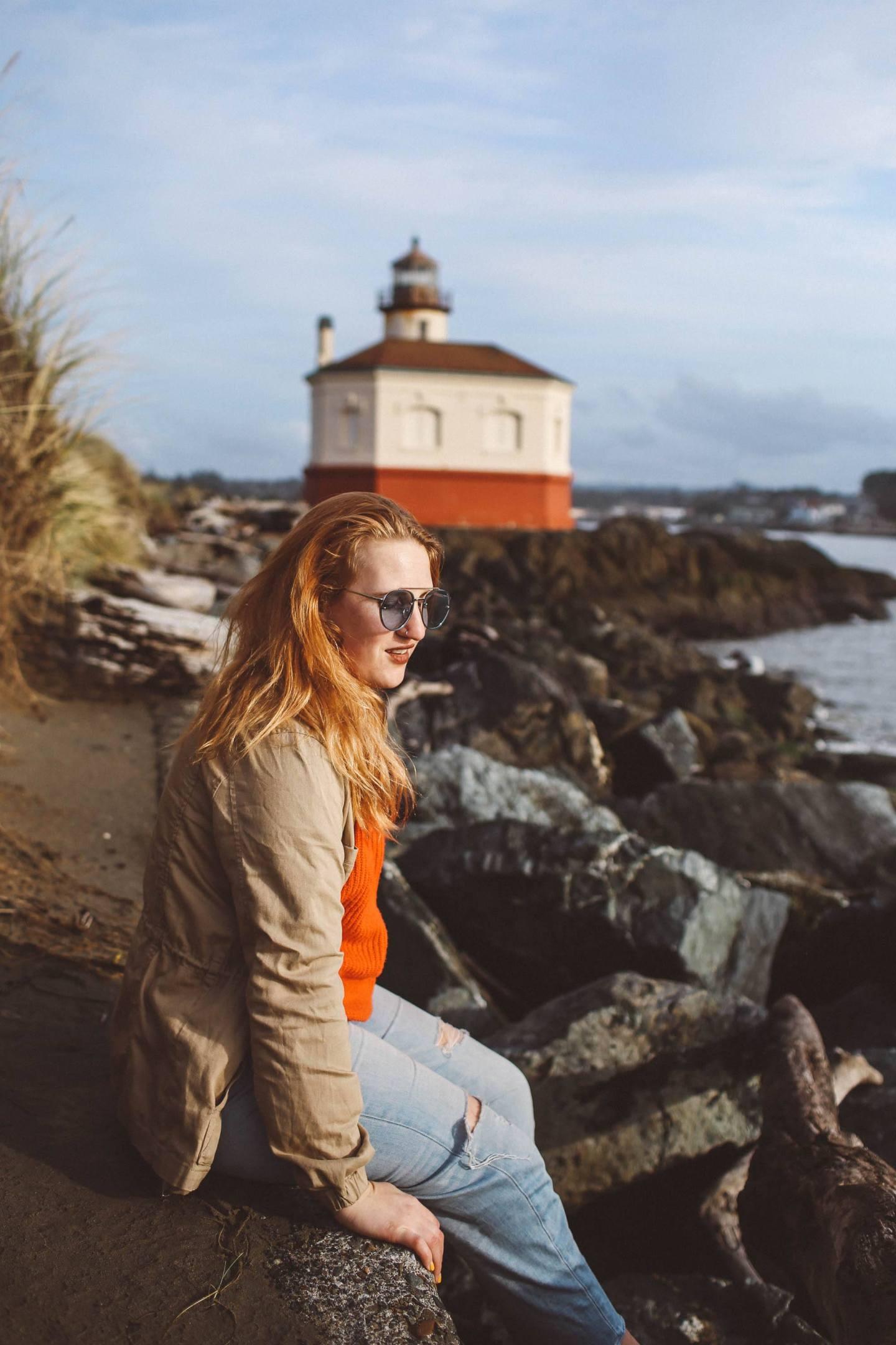 oregon lighthouse bandon woman red sweater