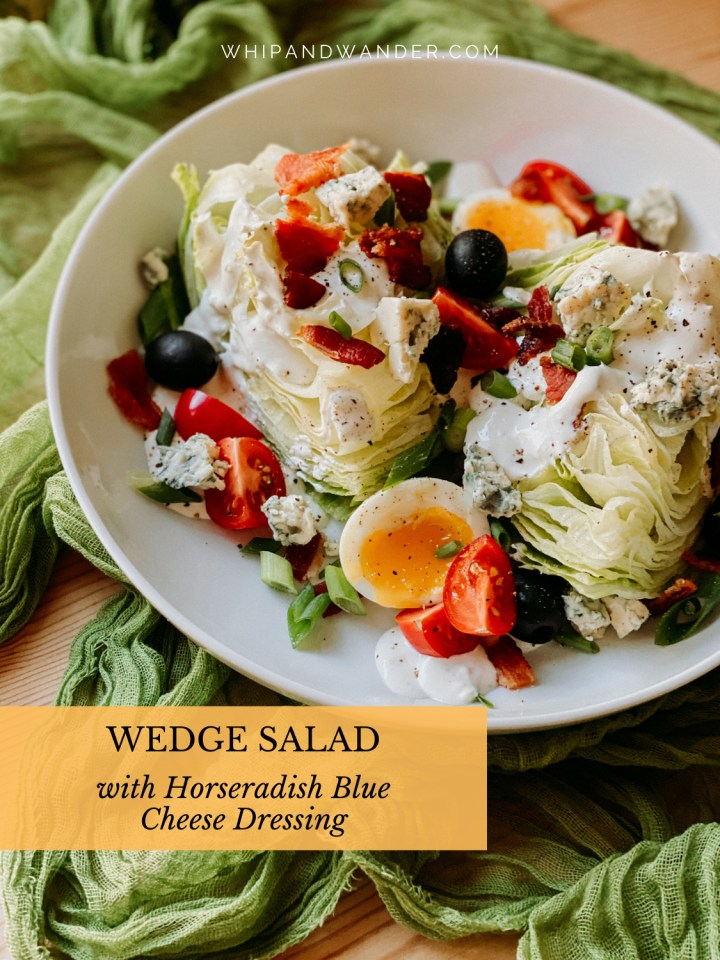 a white dish filled with a wedge salad with blue cheese, bacon, and eggs
