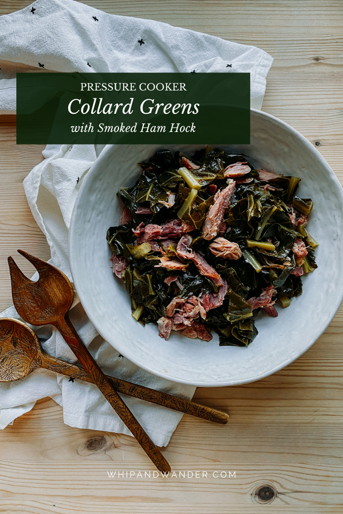 a white serving bowl with Pressure Cooker Collard Greens with Smoked Ham Hock resting on a white towel with serving utensils sitting on the towel on a wooden surface
