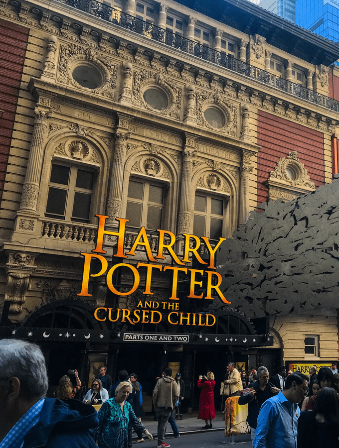 Harry Potter and the cursed child sign on a brick building