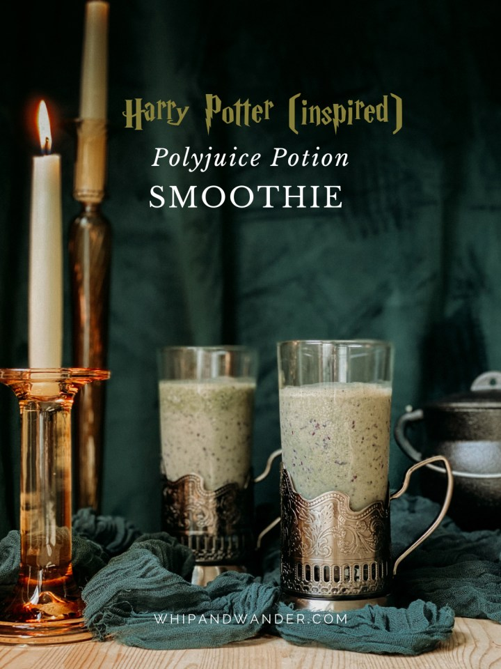 metal bottomed glasses of Polyjuice Potion Smoothie in front of dark green drapery with lite candlesticks
