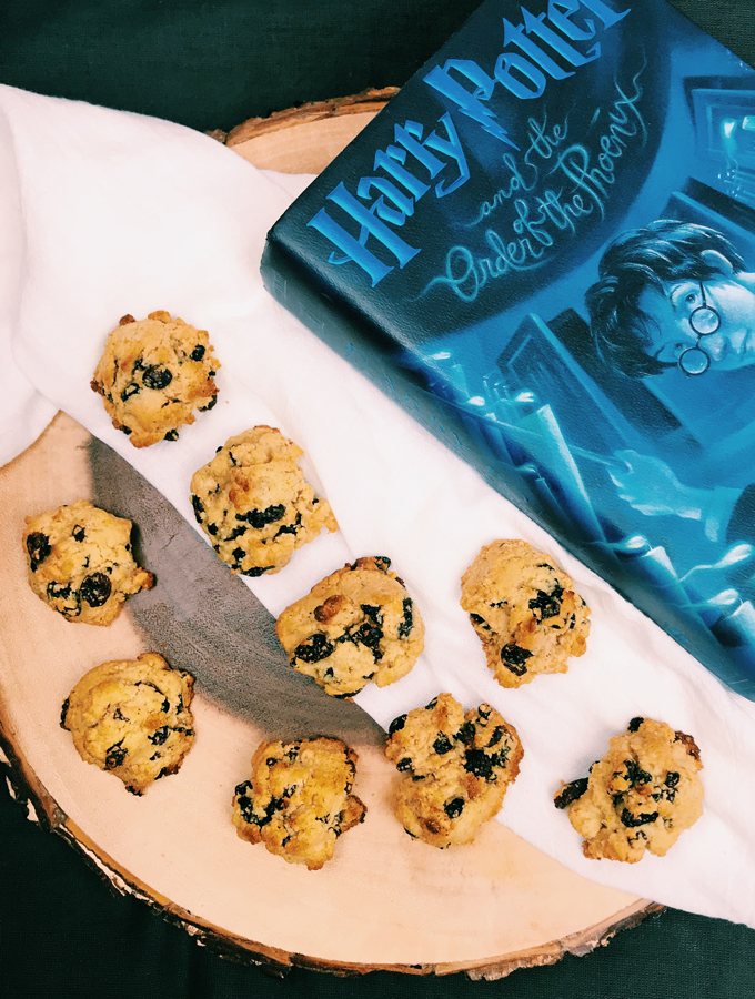 rock cakes on a tree stump with a blue book and a white towel