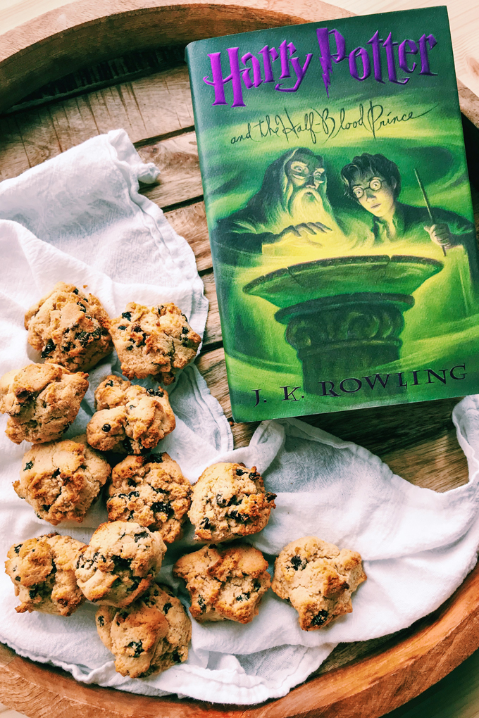 a harry potter book next to a pile of rock cakes