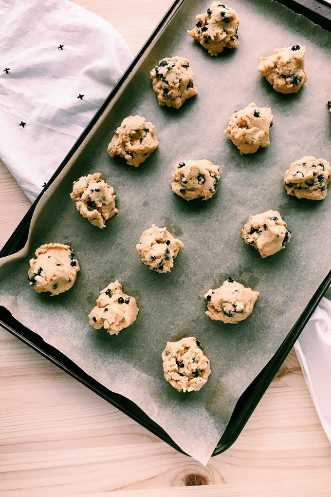 a tray of unbaked rock cakes on parchment paper