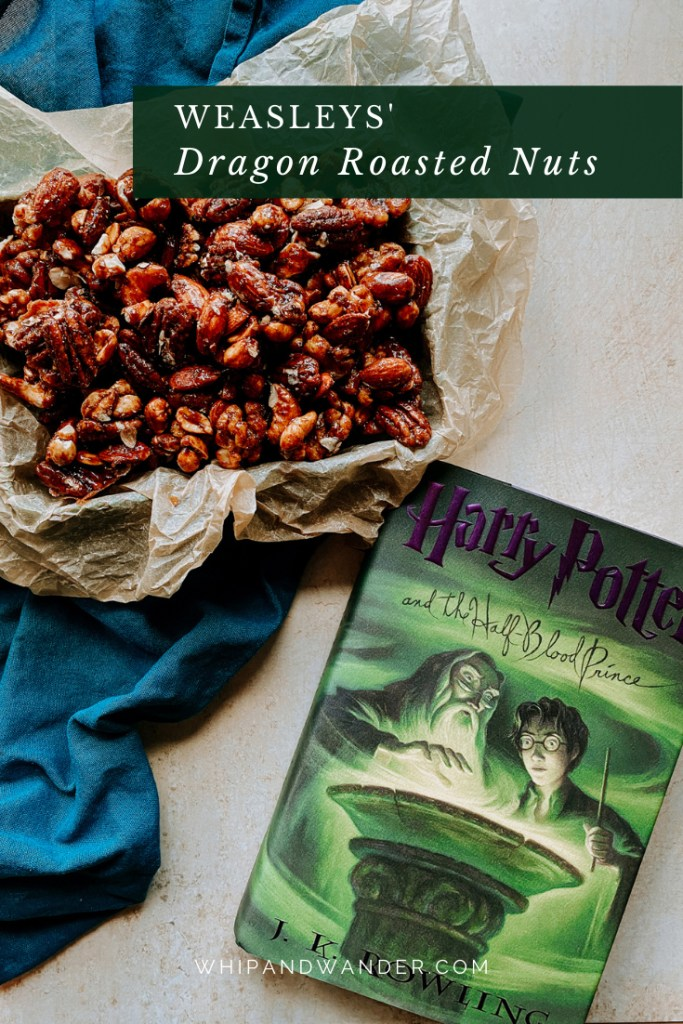 harry potter and the half blood prince book resting next to a tin of Weasleys Dragon Roasted Nuts on a blue towel