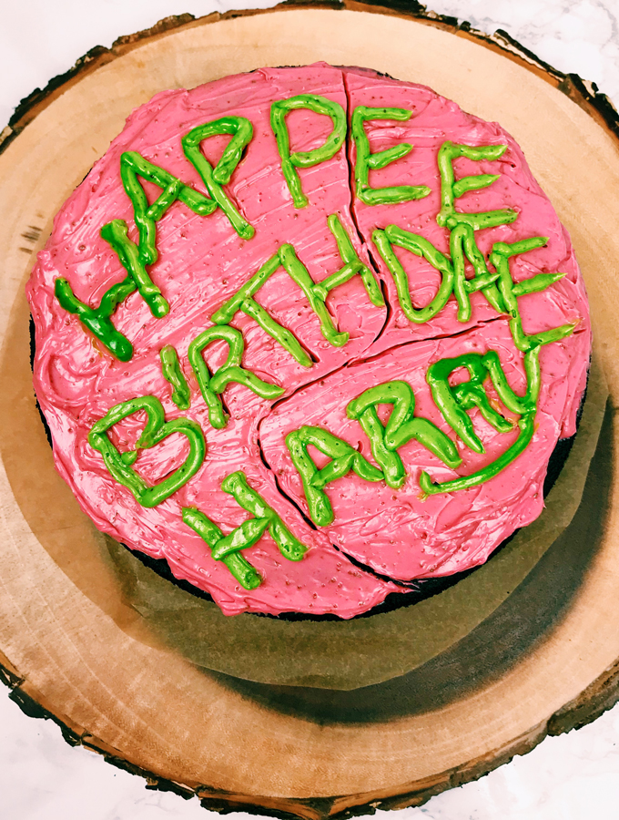 green and red iced birthday cake that reads happee birthdae harry