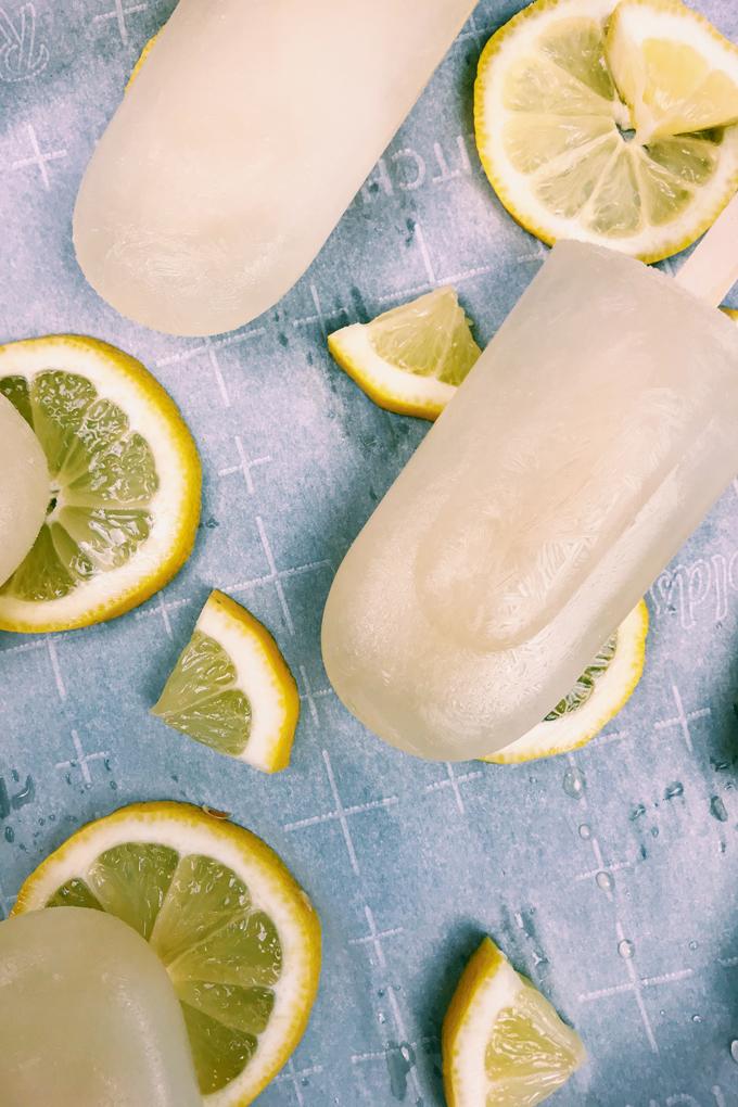 closeup of lemon ice pop and lemon wedges on a tray