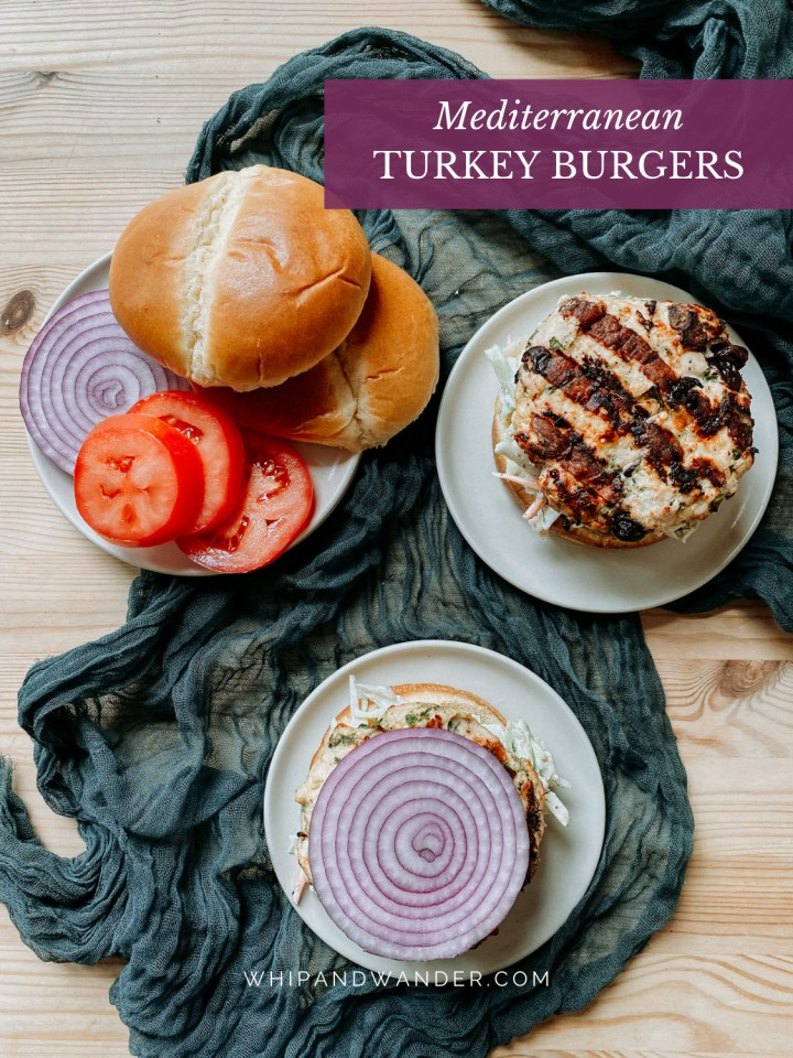 tomato slices and red onion slices topping turkey burgers with buns on the side