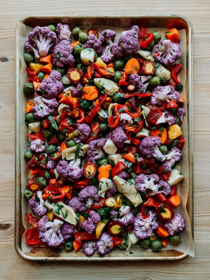 a sheet pan of Mediterranean Rainbow Vegetables prior to roasting