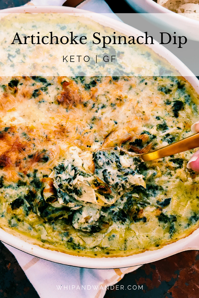 white text box over a dish of artichoke spinach dip with a gold spoon scooping it up