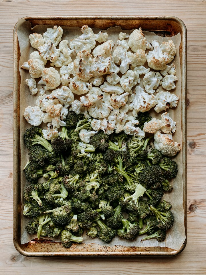 a sheet pan of roasted broccoli and cauliflower florets