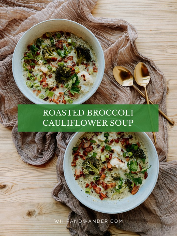 two bowls with Roasted Broccoli Cauliflower Soup topped with bacon resting on a mauve cloth