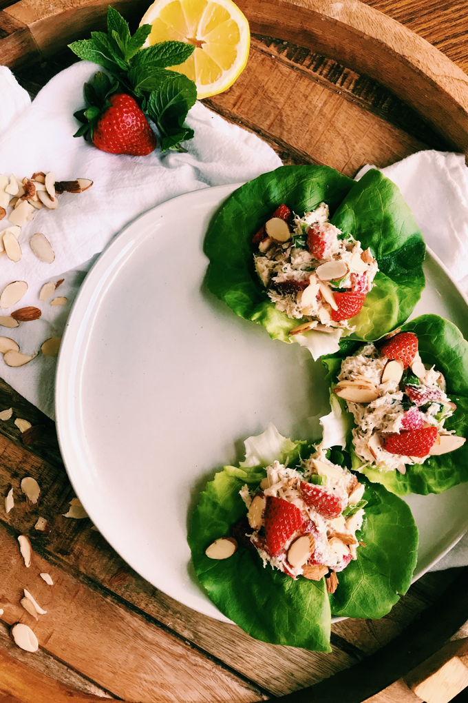 strawberry chicken salad on butter lettuce on a white plate