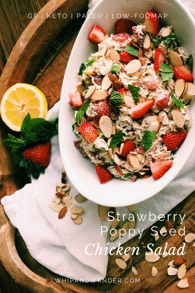 white text on white dish with strawberry poppy seed chicken salad with mint and lemon on the side