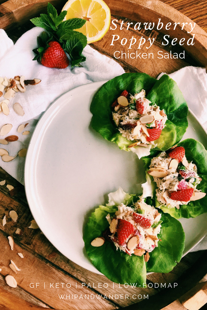 white text on strawberry chicken salad on butter lettuce on a white plate