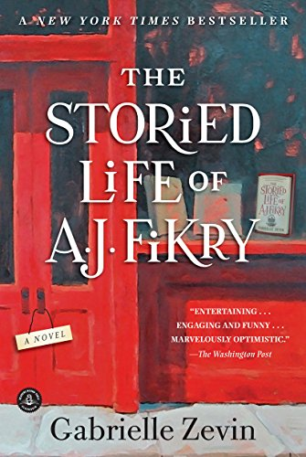 a red storefront with books in the window and white text across the front that says The Storied Life of A.J. Fikry