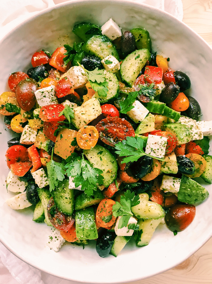 closeup of greek salad in a white bowl