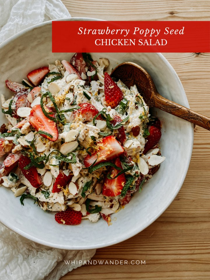 a wooden spoon in a bowl of Strawberry Poppy Seed Chicken Salad in a white bowl