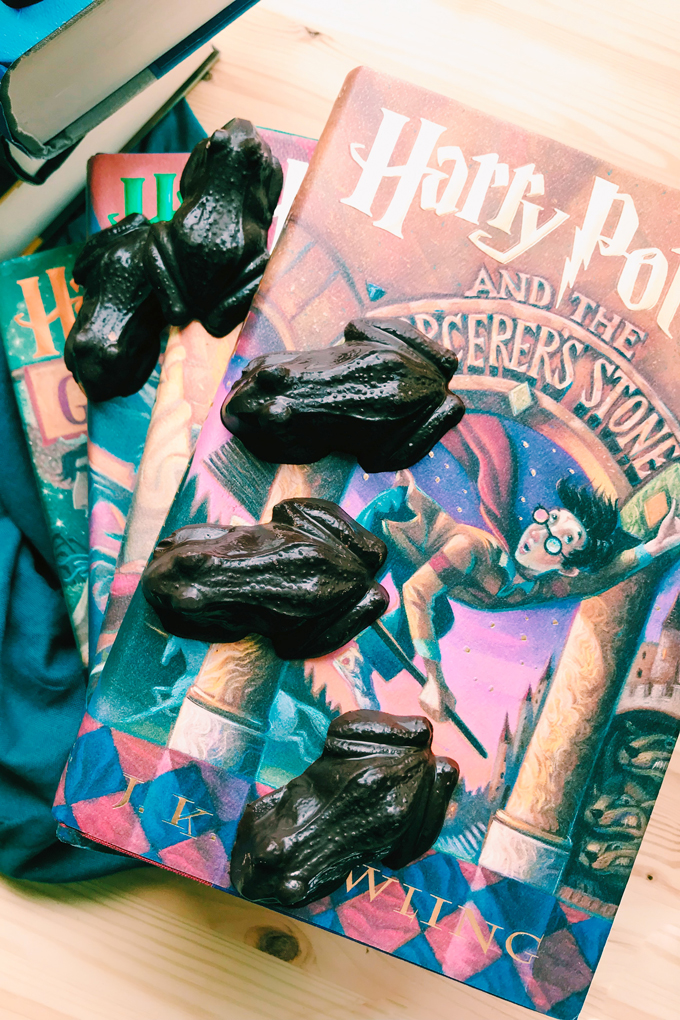 a harry potter book with dark chocolates resting on top
