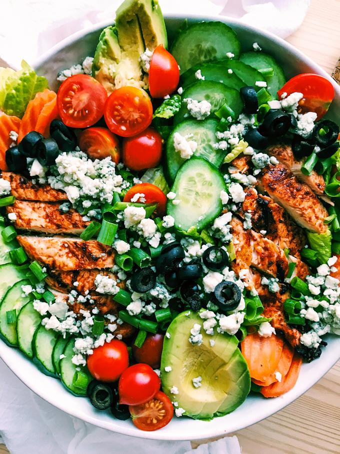 closeup of bbq chicken salad with veggies