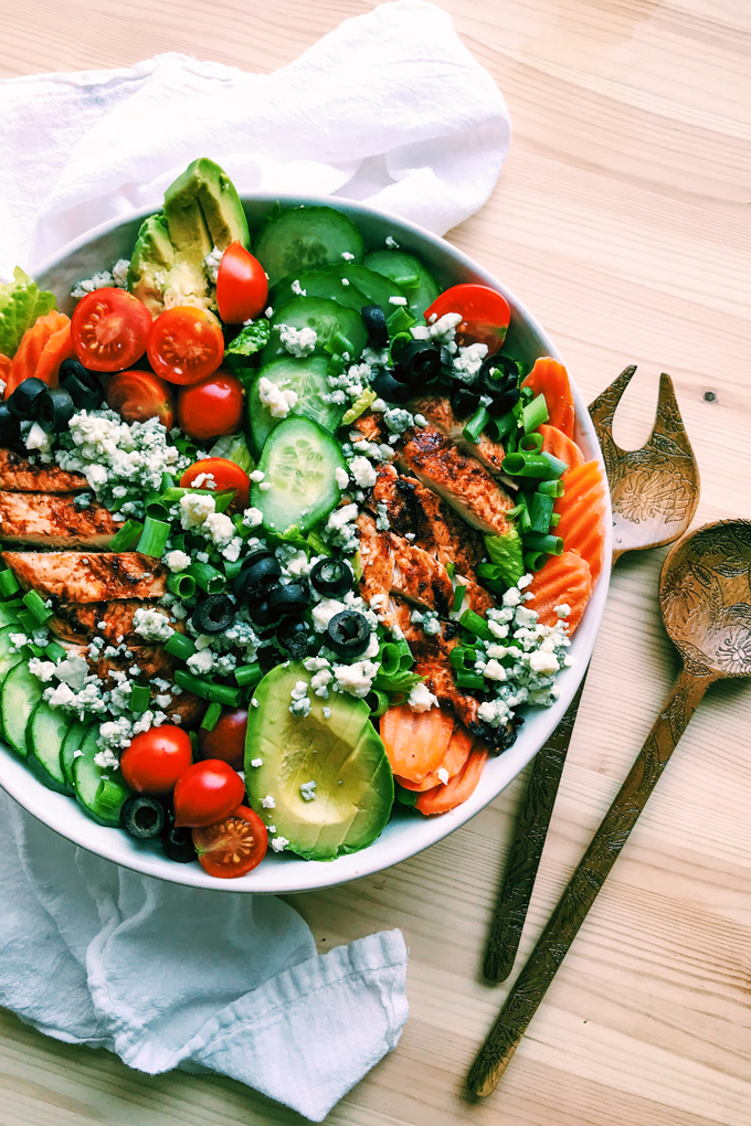 bbq chicken salad with avocado, tomato, cucumber, green onion, olives