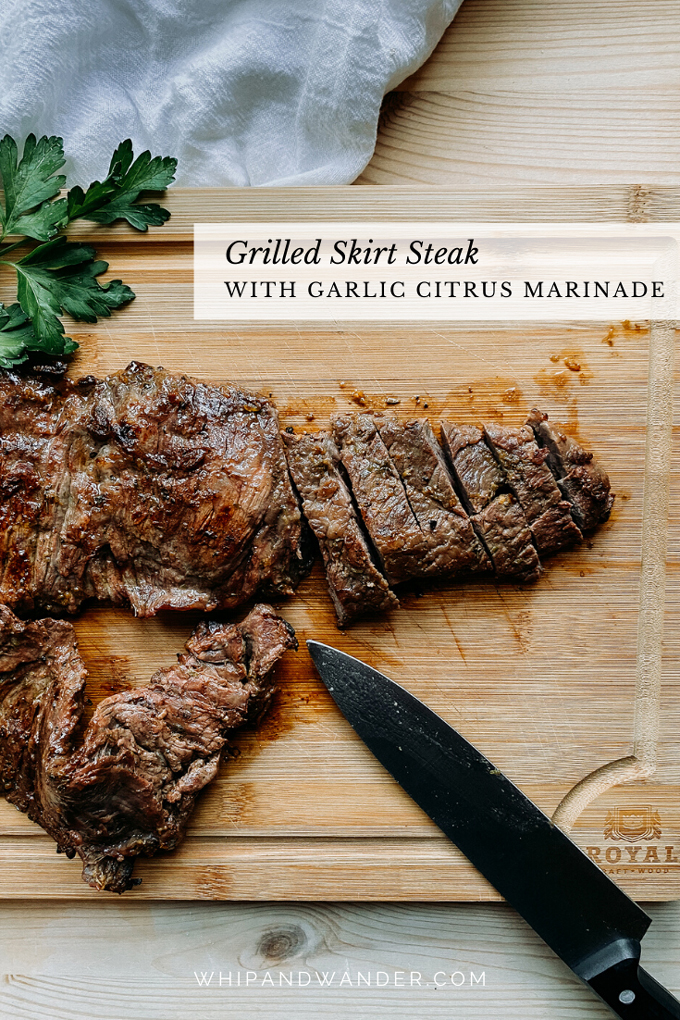 slices of grilled skirt steak with a citrus marinade on a wood cutting board